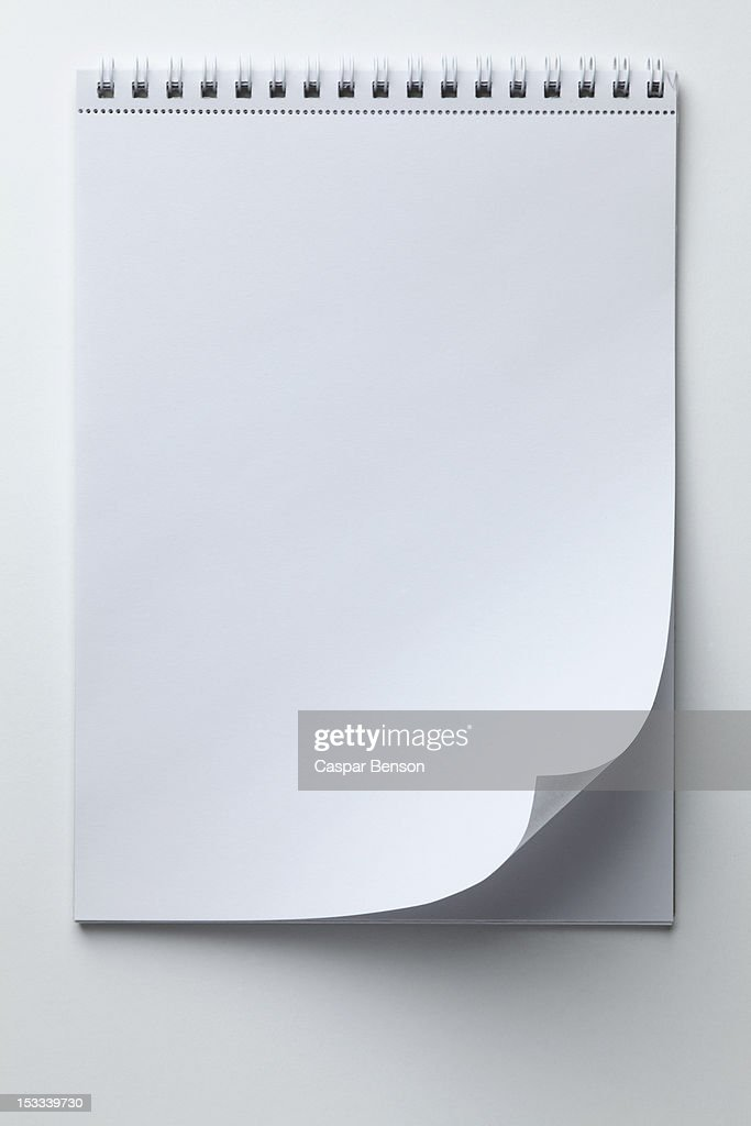 A blank sketch pad with curled up page corner