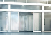 Blank sliding glass doors entrance mockup, 3d rendering. Commercial automatic slide entry mock up. Office building exterior template. Closed transparent business centre facade, front view.