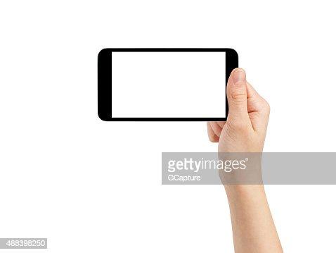 Mano mujer adolescente tomando fotos con genérico smartphone, aislado : Foto de stock