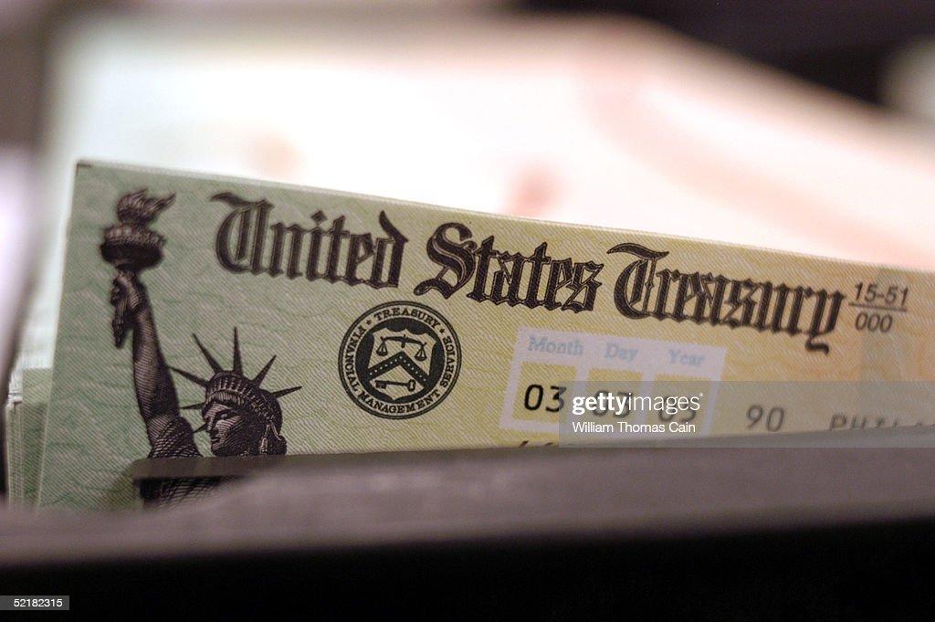 Blank Social Security checks are run through a printer at the US Treasury printing facility February 11 2005 in Philadelphia Pennsylvania As US...