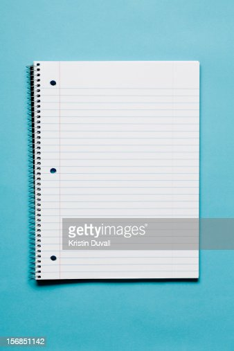 Blank spiral notebook on blue background