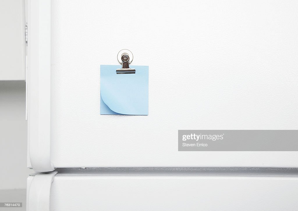 Blank sticky notes on fridge door : Stock Photo