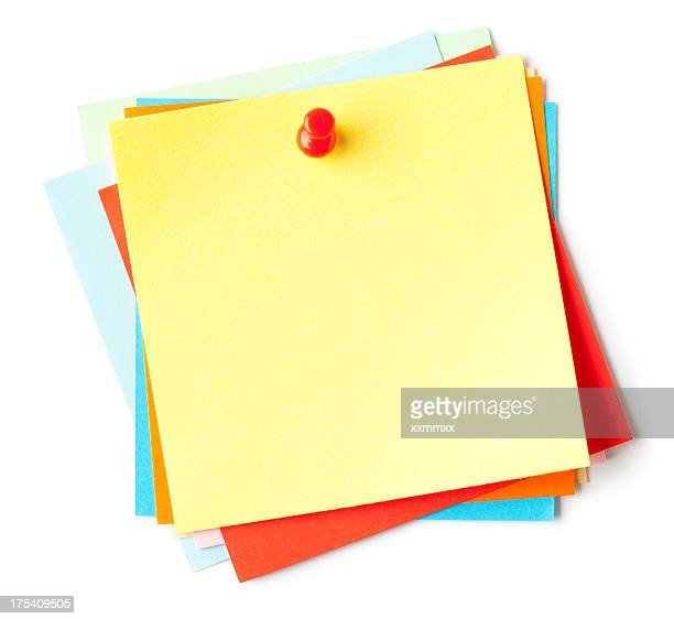 Blank sticky notes with a push pin