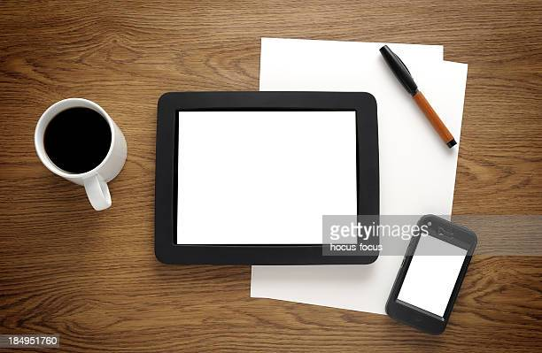 Blank tablet pc and smart phone on desk