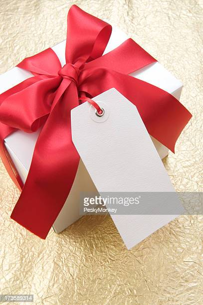 Blank Tag Gift with Red Bow Gold Background