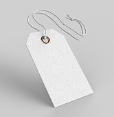 Blank tag tied with string. Price tag, gift tag, sale tag, address label isolated on grey background.