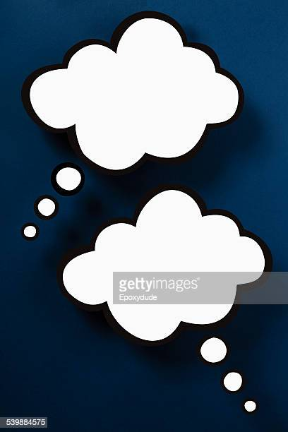 Blank thought bubbles against blue background