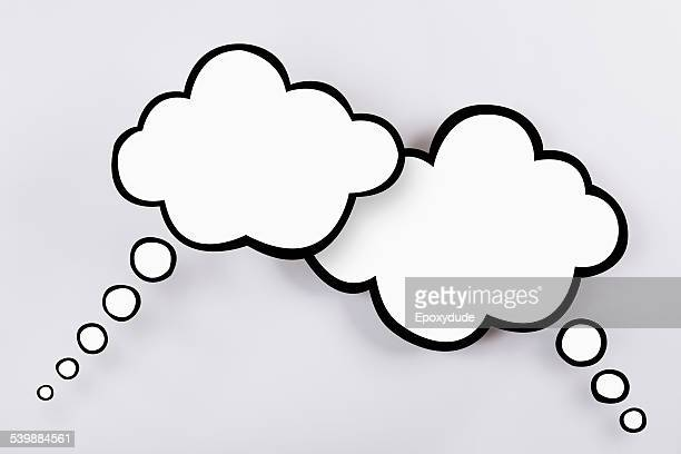Blank thought bubbles against gray background