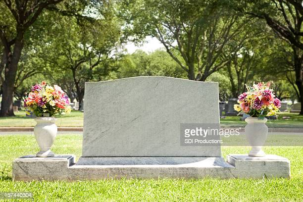 Blank Tombstone at Cemetery with Flowers