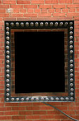 Blank unlit marquee sign on brick wall