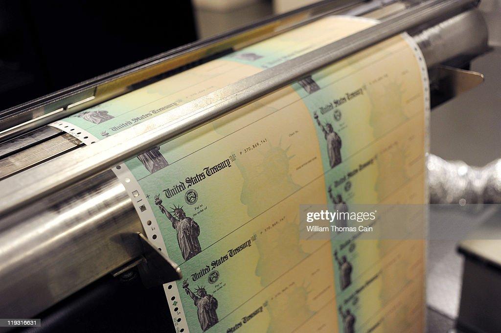 Blank US Treasury checks run through a printer at the US Treasury printing facility July 18 2011 in Philadelphia Pennsylvania US President Barack...