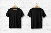 Blank V-Neck T-Shirts Mock-up hanging on white brick wall, front and rear side view . Ready to replace your design.