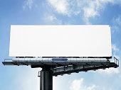 Blank white billboard against blue sky