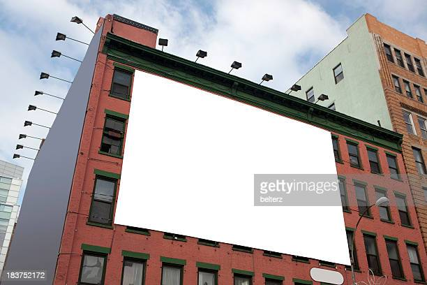 Blank white billboard on the side of a tall building