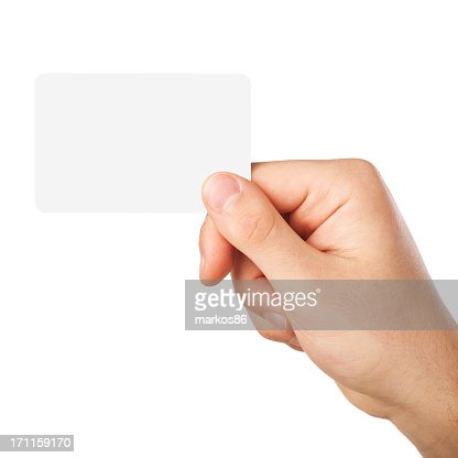 A blank white business card being held