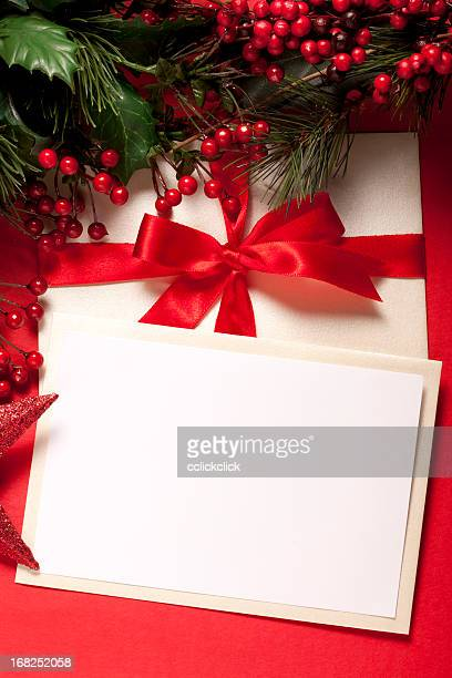 A blank white Christmas card with a red ribbon