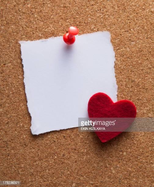 blank white note paper on cork board