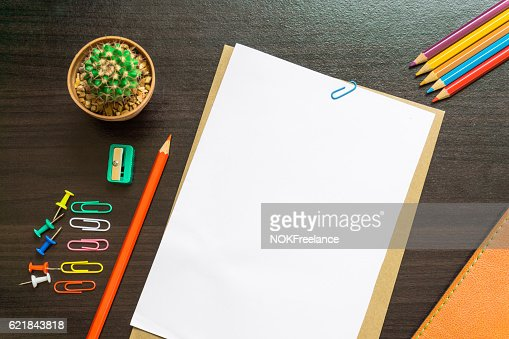 Blank white paper and colored pencil on the desk. : Stock Photo