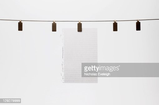 Hanging Pictures On Wire blank green paper hanging on wire stock photo | getty images