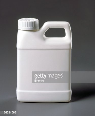 Blank white plastic jug on a gray background