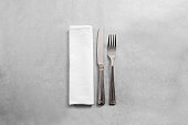 Blank white restaurant napkin mock up with fork and knife, isolated. Cutlery near clear textile towel mock up template. Cafe branding identity clean napkin surface for restaurant logo design branding.
