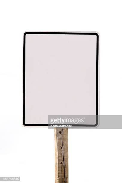 Blank white speed limit sign on a stick over white backdrop