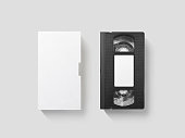 Blank white video cassette tape mockup, isolated, top view, clipping path. Clear vhs cassete case design mock up. Retro tv videotape cover template. Analog movie casette box copy with sticker