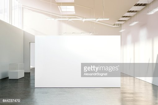 Blank white wall mockup in sunny modern empty museum : Stock Photo