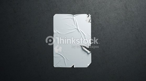Blank white wheatpaste adhesive torn poster mockup black textured wall : Stock Photo
