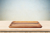 Blank wood tray on table background, product display montage