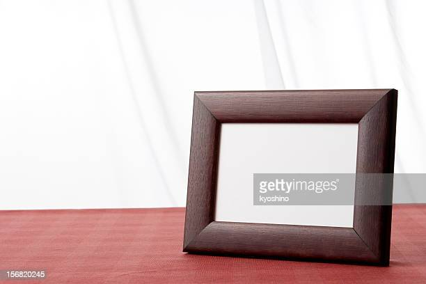 Blank wooden picture frame on the table with copy space