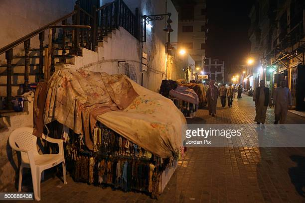A blanket covers goods of a vendor to show its closed during the prayer time at night on December 9 2015 in Jeddah Saudi Arabia All shops restaurants...
