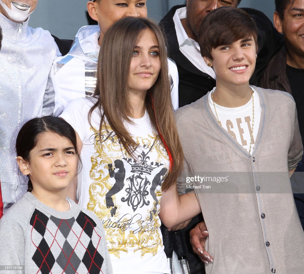 Blanket Jackson, Paris Jackson and Justin Bieber attend the Michael Jackson 'Immortalized' hand and footprint ceremony held at Grauman's Chinese Theatre on January 26, 2012 in Hollywood, California.