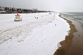 BEACH CA MARCH 2 2015 A blanket of hail covers the beach justing south of the Huntington Beach pier Monday March 2 2015