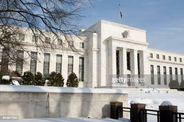 A blanket of snow covers the Federal Reserve building in Washington DC US on Monday Dec 21 2009 The market for Treasury inflation protected...
