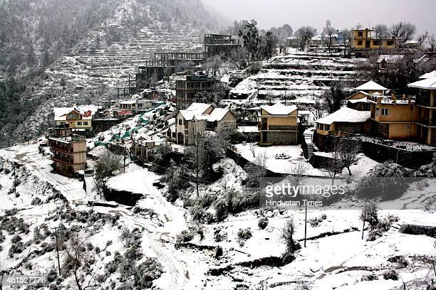 Blanket of snow forms over houses and terrain of Naddi village as intense cold waves persists in the region with snowfall on January 14 2015 in...