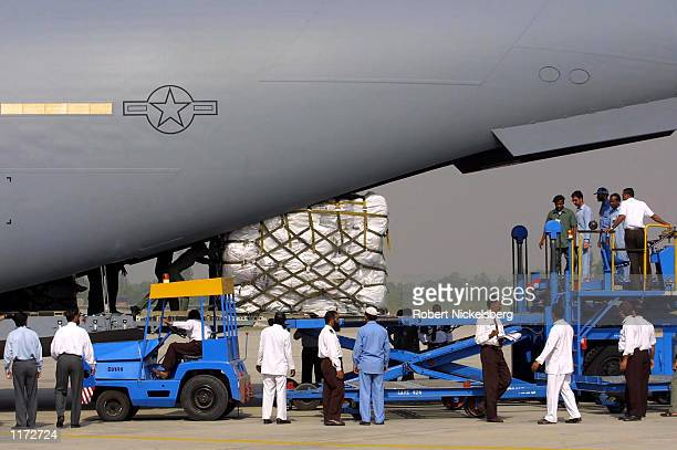 35000 blankets donated from USAID are unloaded from a US Air Force C17 cargo plane October 23 2001 at Chaklala Air Force Base near Rawalpindi...