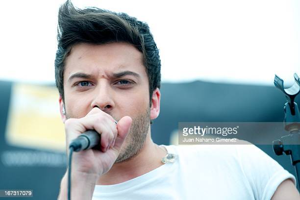 Blas Canto of Spanish boyband Auryn performs a song from the movie 'Viral' on stage at Fnac tent during '16 Malaga Film Festival' on April 24 2013 in...