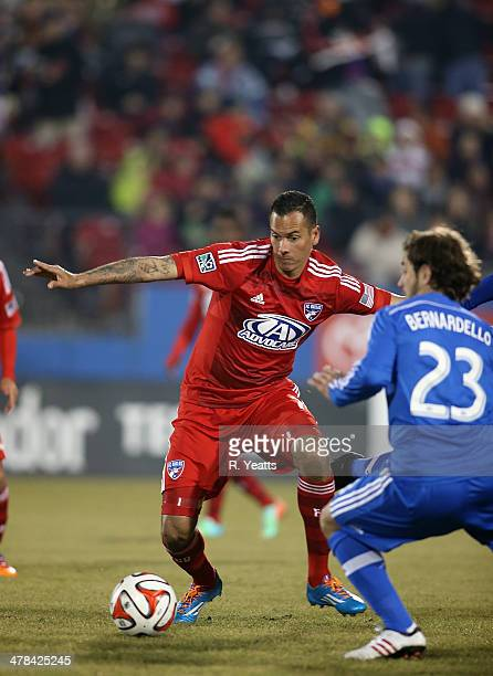 Blas Perez of FC Dallas defends the ball from Hernan Bernardello of Montreal Impact at Toyota Stadium on March 8 2014 in Frisco Texas