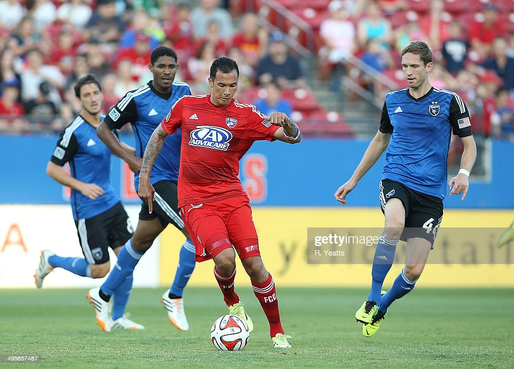 Blas Perez of FC Dallas handles the ball against Clarence Goodson of San Jose Earthquakes at Toyota Stadium on May 31 2014 in Frisco Texas