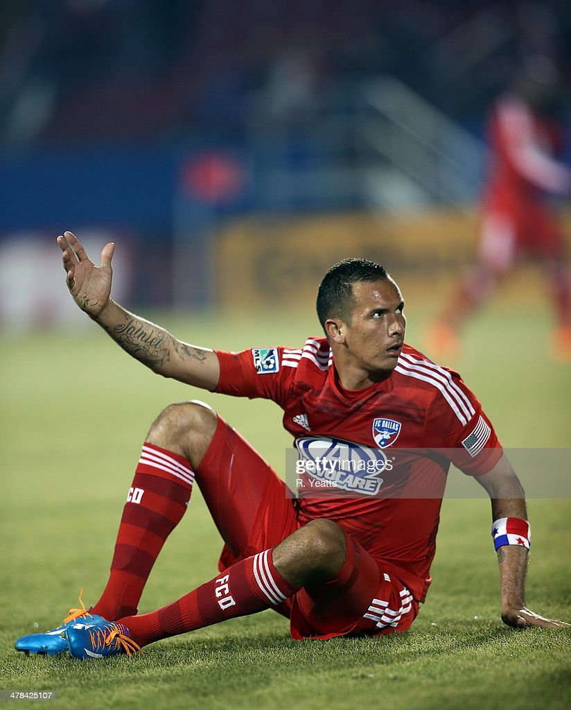 <a gi-track='captionPersonalityLinkClicked' href=/galleries/search?phrase=Blas+Perez&family=editorial&specificpeople=4084276 ng-click='$event.stopPropagation()'>Blas Perez</a> #7 of FC Dallas reacts after a slide tackle during the match against the Montreal Impact at Toyota Stadium on March 8, 2014 in Frisco, Texas.