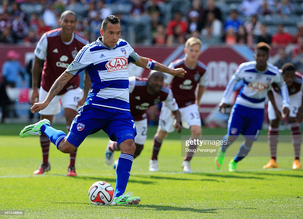 <a gi-track='captionPersonalityLinkClicked' href=/galleries/search?phrase=Blas+Perez&family=editorial&specificpeople=4084276 ng-click='$event.stopPropagation()'>Blas Perez</a> #7 of FC Dallas scores a goal against goalkeeper Clint Irwin #1 of Colorado Rapids on a penalty kick in the 56th minute as Marvell Wynne #22 of Colorado Rapids walks up field at Dick's Sporting Goods Park on October 18, 2014 in Commerce City, Colorado. FC Dallas defeated the Rapids 1-0.