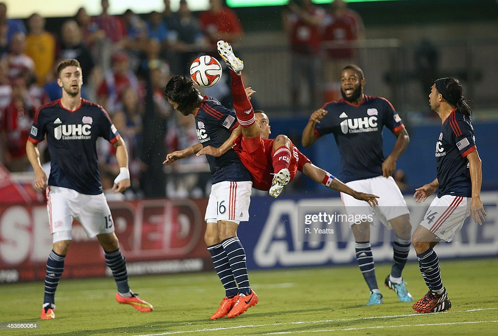 <a gi-track='captionPersonalityLinkClicked' href=/galleries/search?phrase=Blas+Perez&family=editorial&specificpeople=4084276 ng-click='$event.stopPropagation()'>Blas Perez</a> #7 of FC Dallas tries to kick the ball in midair from behind <a gi-track='captionPersonalityLinkClicked' href=/galleries/search?phrase=Daigo+Kobayashi&family=editorial&specificpeople=1546143 ng-click='$event.stopPropagation()'>Daigo Kobayashi</a> #16 of New England Revolution at Toyota Stadium on July 19, 2014 in Frisco, Texas.