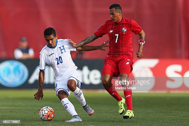Blas Perez of Panama defends Jorge Claros of Honduras during the 2015 CONCACAF Gold Cup match between Honduras and Panama at Gillette Stadium on July...
