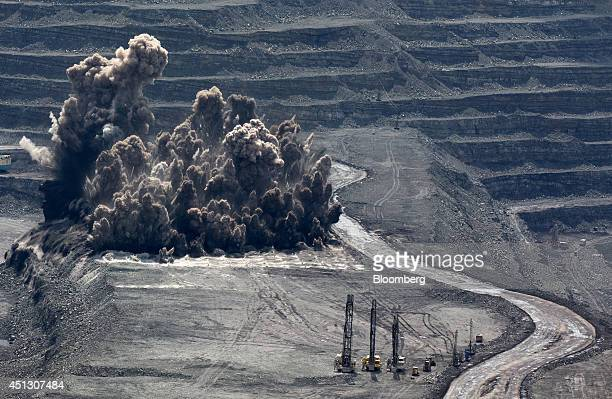 Blast debris from a detonation rises from the open pit during the excavation of coking coal at the Neryungrinsky mine operated by OAO Mechel in...