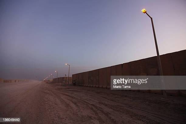 Blast walls line an empty street as soldiers from the 3rd Brigade 1st Cavalry Division prepare to depart in the last convoy from Iraq at Camp Adder...
