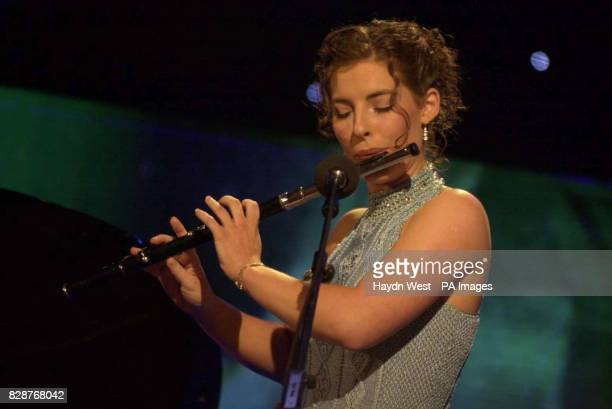 Blathnaid Nuallain representing the Fodhla the Irish speaking areas of Ireland plays the flute in the televised final of the 2003 Rose of Tralee...