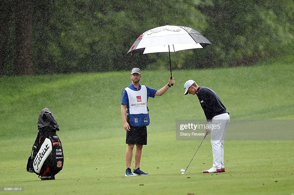 Blayne Barber prepares to hit his approach shot on the 12th hole during the first round of the Wells Fargo Championship at Quail Hollow on May 5, 2016 in Charlotte, North Carolina.