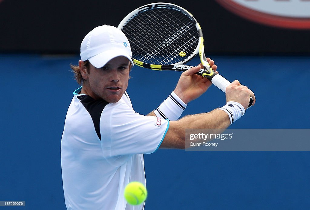 <a gi-track='captionPersonalityLinkClicked' href=/galleries/search?phrase=Blaz+Kavcic&family=editorial&specificpeople=7023045 ng-click='$event.stopPropagation()'>Blaz Kavcic</a> of Slovakia plays a backhand in his second round match against Juan Martin Del Potro of Argentina during day three of the 2012 Australian Open at Melbourne Park on January 18, 2012 in Melbourne, Australia.