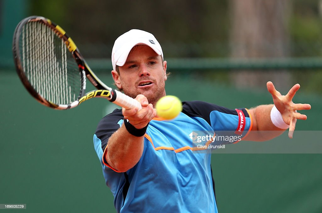 <a gi-track='captionPersonalityLinkClicked' href=/galleries/search?phrase=Blaz+Kavcic&family=editorial&specificpeople=7023045 ng-click='$event.stopPropagation()'>Blaz Kavcic</a> of Slovenia plays a forehand during his men's singles match against James Duckworth of Australia during day one of the French Open at Roland Garros on May 26, 2013 in Paris, France.